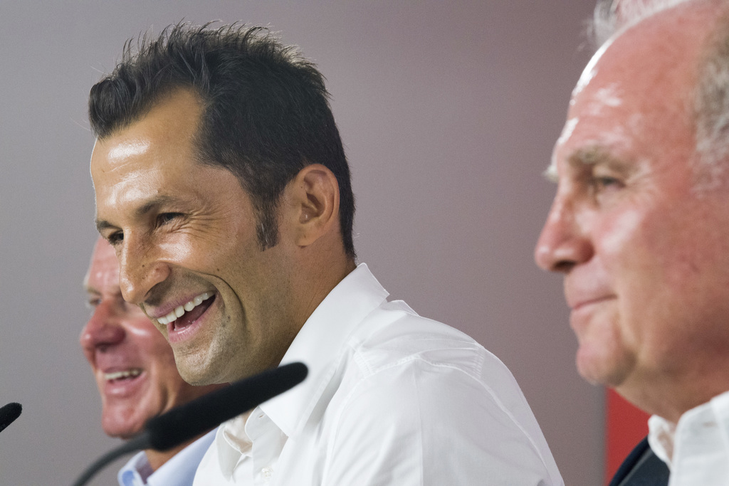 Hasan Salihamidzic center, is framed by Bayern CEO Karl-Heinz Rummenigge, left, and Bayern Munich  president Uli Hoeness, right, in Munich, Germany, M...