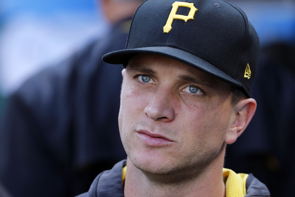 In this July 15, 2017, photo, Pittsburgh Pirates relief pitcher Tony Watson sits in the dugout during a baseball game against the St. Louis Cardinals ...
