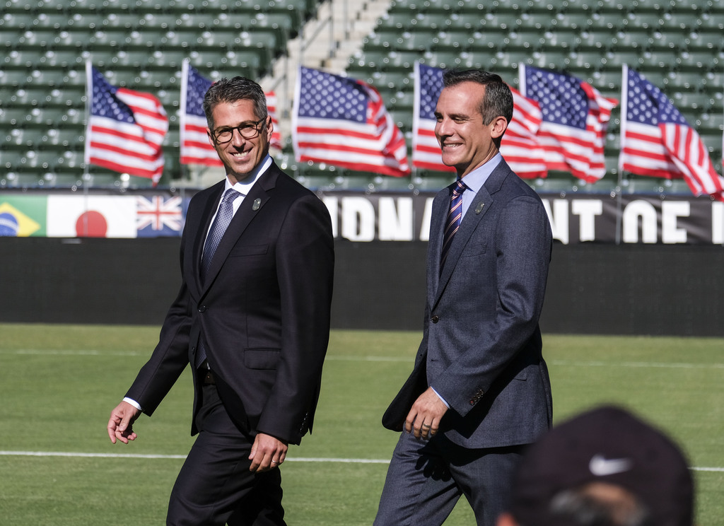 Los Angeles Mayor Eric Garcetti, right, and L.A. Olympic Committee leader Casey Wasserman arrive at a press conference to make an announcement for the...