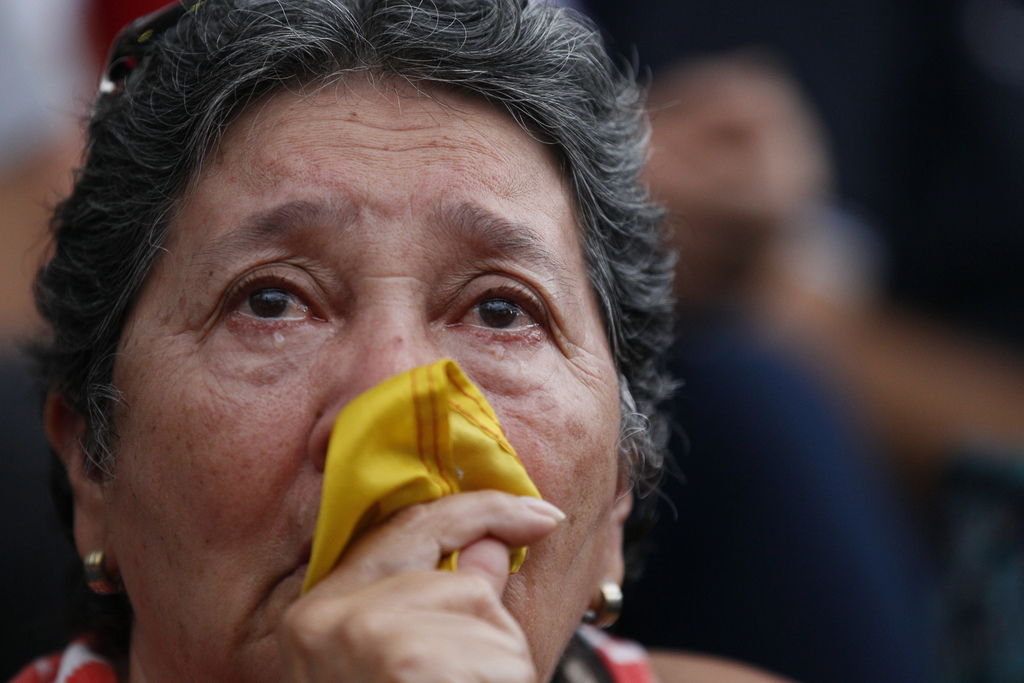 An anti-government demonstrator cries during a vigil in honor of those who have been killed during clashes between security forces and demonstrators i...