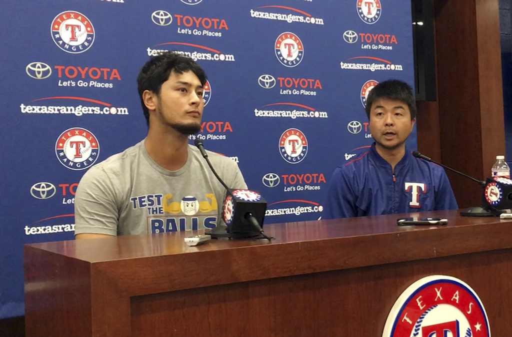 Former Texas Rangers pitcher Yu Darvish, left, responds to a question with help from his translator Hideaki Sato during a news conference regarding hi...