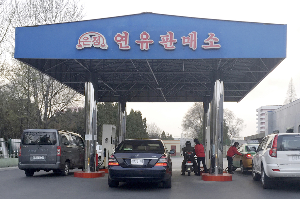 n this April 1, 2016, photo, cars line up at at a gas station in Pyongyang, North Korea. North Korea has been condemned and sanctioned for its nuclear...