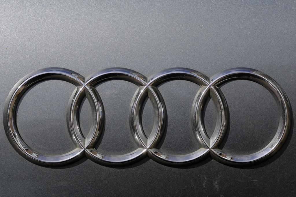 The brand logo of German car maker Audi is photographed on a car in Berlin, Tuesday, Aug. 1, 2017. German Transport Minister Alexander Dobrindt and En...