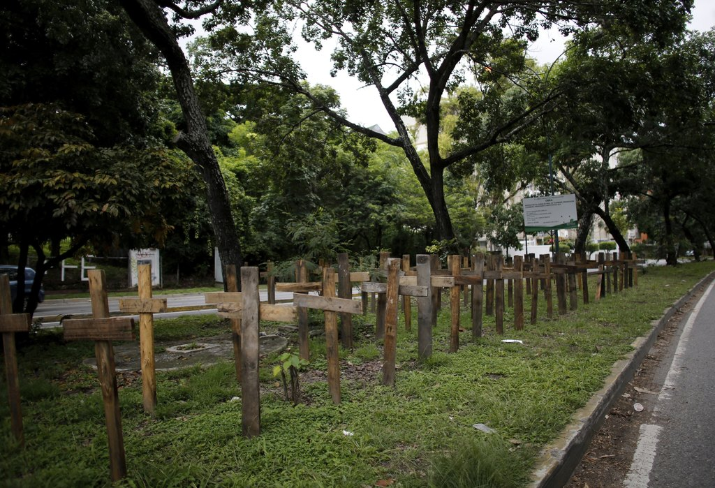 Wooden crosses representing the death toll in nearly 4 months of civil unrest line a median strip in Caracas, Venezuela, Monday, July 31, 2017. Venezu...