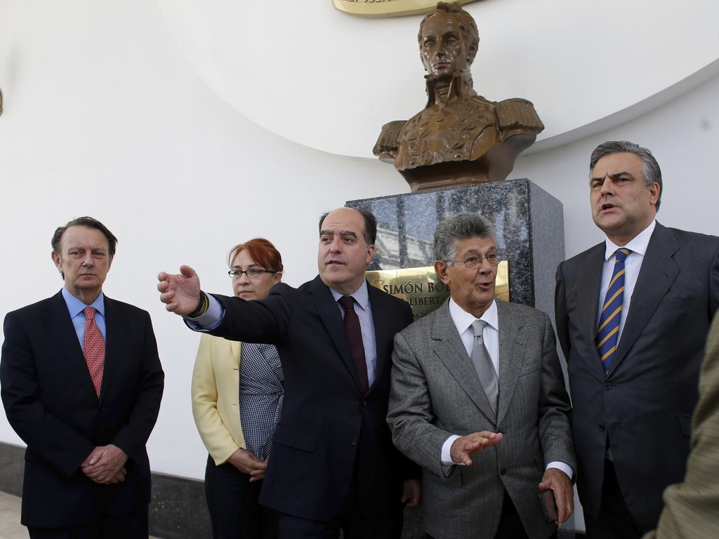 The President of Venezuela's National Assembly, Julio Borges, center, and his colleague lawmaker Henry Ramos Allup, center right, pose with the ambass...