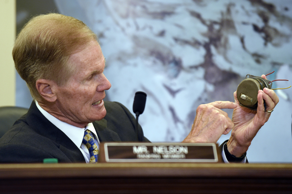 FILE - In this Tuesday, June 23, 2015, file photo, Sen. Bill Nelson, D-Fla., holds a Takata airbag inflator during a Senate Commerce, Science, and Tra...