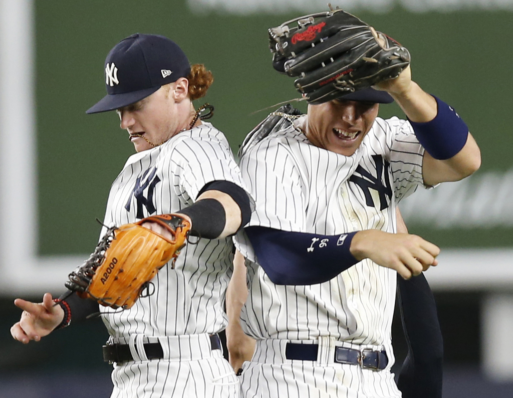 New York Yankees left fielder Clint Frazier, left, and Yankees right fielder Aaron Judge celebrate after the Yankees 7-3 victory over the Detroit Tige...