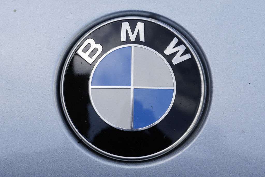 The brand logo of German car maker BMW is photographed on a car in Berlin, Tuesday, Aug. 1, 2017. German Transport Minister Alexander Dobrindt and Env...