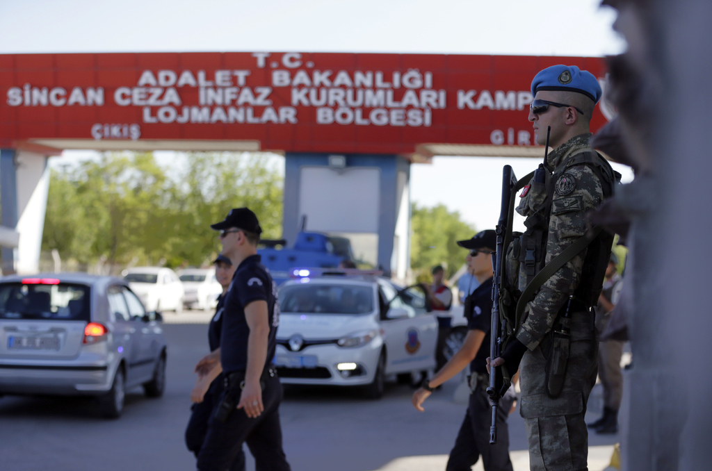 A member of the special forces stands guard outside the courthouse at the start of a trial, in Ankara, Turkey, Tuesday, Aug. 1, 2017.  Nearly 500 susp...