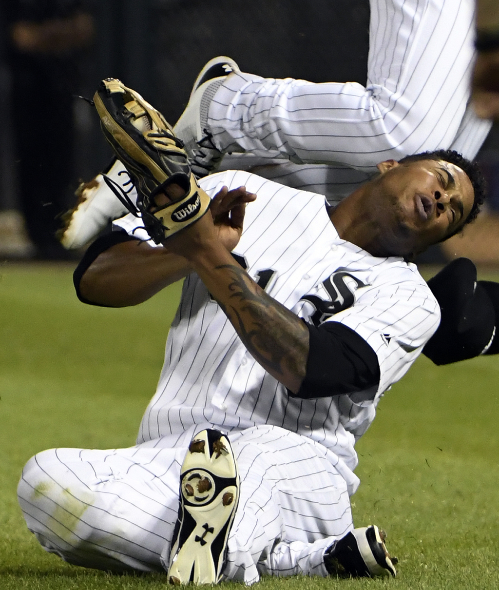 Chicago White Sox second baseman Yoan Moncada, top, and right fielder Willy Garcia, bottom, collide on a double hit by Toronto Blue Jays' Darwin Barne...