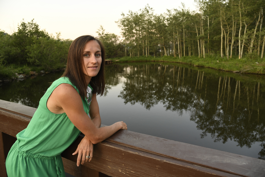 In this June 27, 2017, photo, Sara Vaughn poses for a photo in Nederland, Colo. Vaughn, a mother of three, real estate agent, and burgeoning 1,500-met...