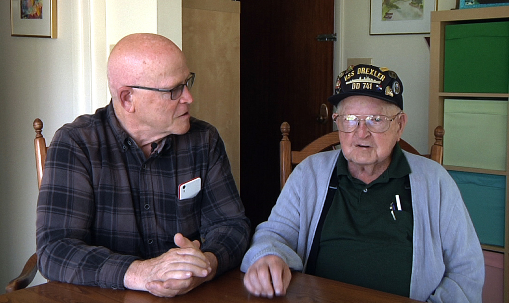 This framegrab from a video shows Gene Brick, 92, right, and his son, Bartt Brick, sit together in Madras, Ore., June 12, 2017. The two, who made a te...