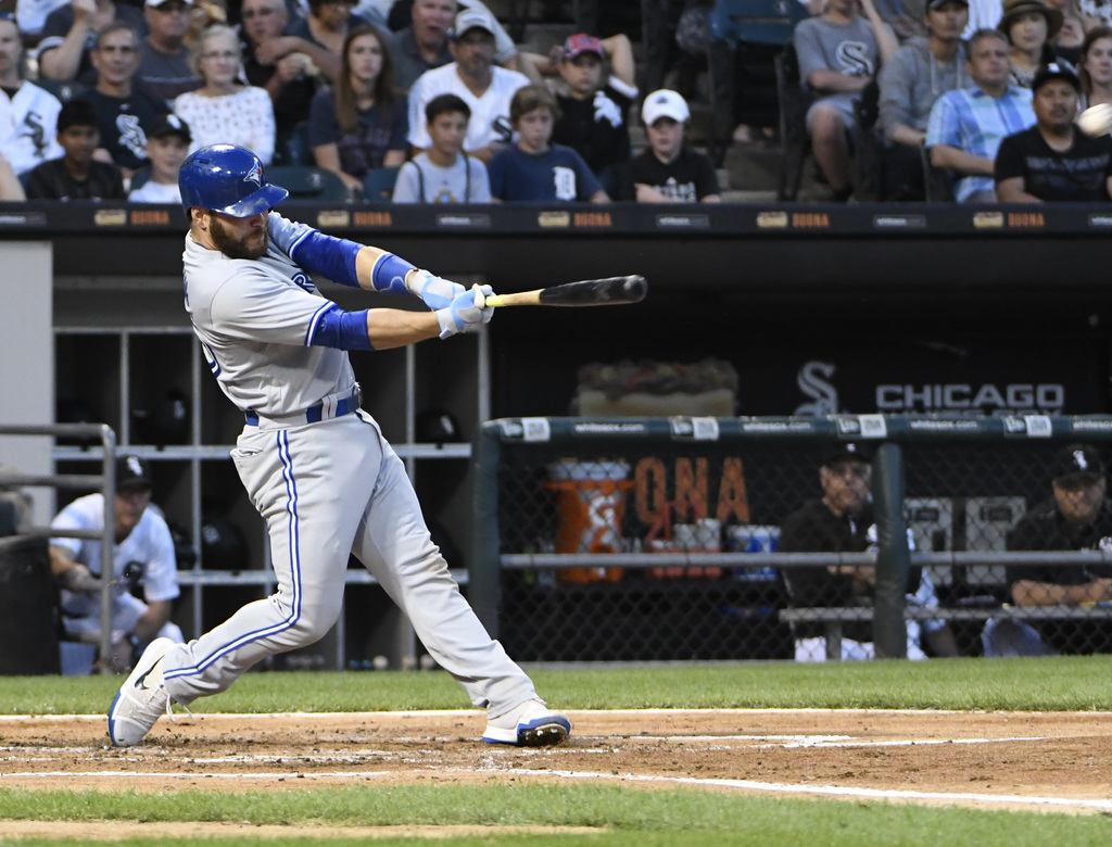 Toronto Blue Jays' Russell Martin (55) hits a home run against the Chicago White Sox during the fourth inning of a baseball game, Monday, July 31, 201...