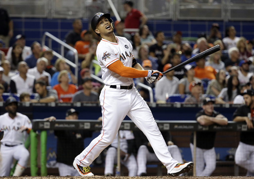 Miami Marlins' Giancarlo Stanton reacts after he flew out to the shortstop during the fourth inning of a baseball game against the Washington National...