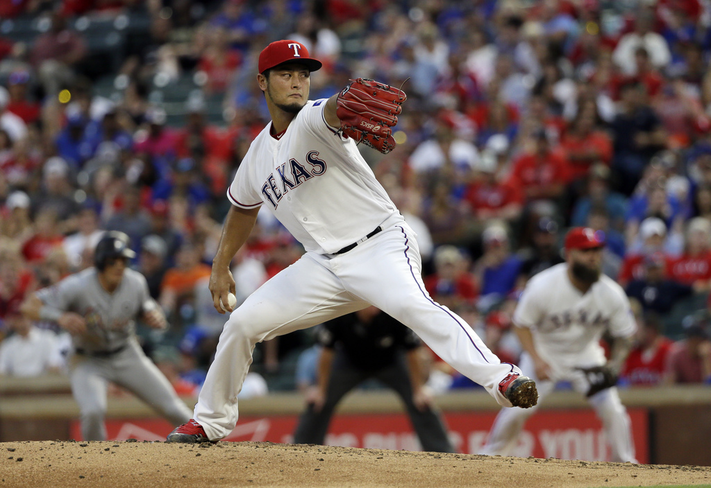 FILE - In this July 26, 2017, file photo, Texas Rangers' Yu Darvish throws to against the Miami Marlins in the fourth inning of a baseball game, in Ar...