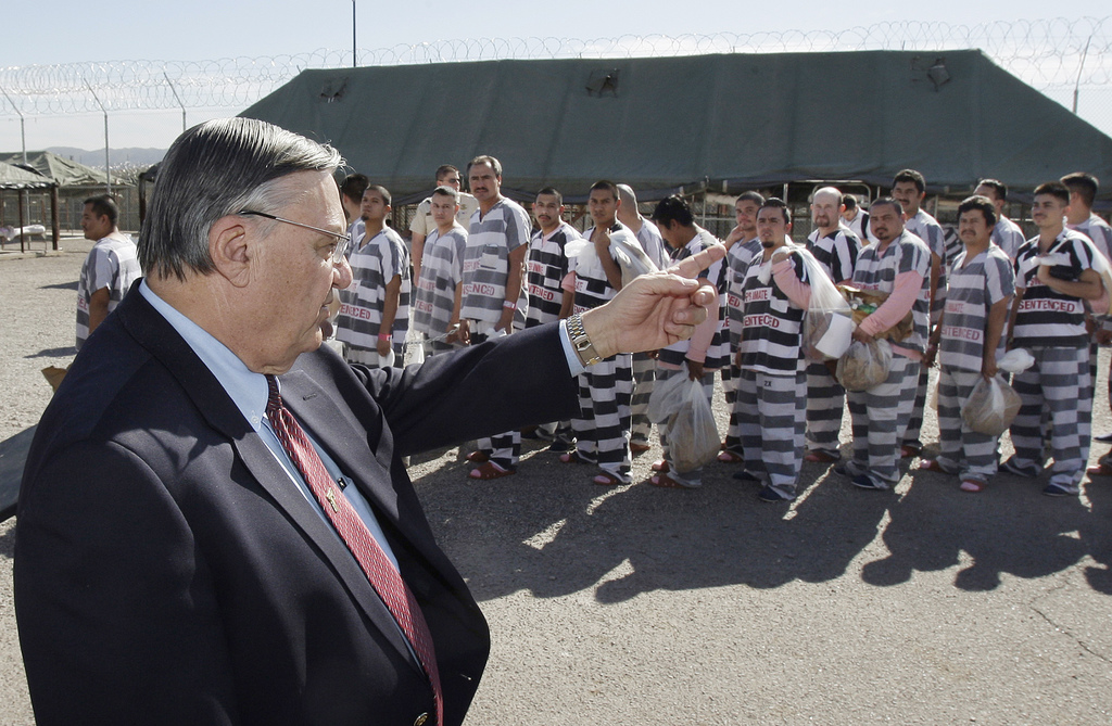FILE- In this Feb. 4, 2009 file photo, Maricopa County Sheriff Joe Arpaio, left, orders approximately 200 convicted illegal immigrants handcuffed toge...