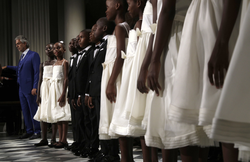 """Tenor Andrea Bocelli performs with the """"Voices of Haiti"""" children's choir during the concert that inaugurates the Franco Zeffirelli International Cent..."""