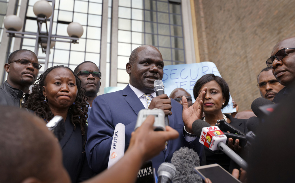 Chairman of Kenya's electoral commission Wafula Chebukati, centre, speaks to the media and civil society groups about the killing of electoral commiss...