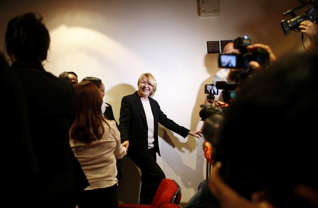 Venezuela's General Prosecutor Luisa Ortega Diaz greets employees and journalists after a news conference at her office in Caracas, Venezuela, Monday,...