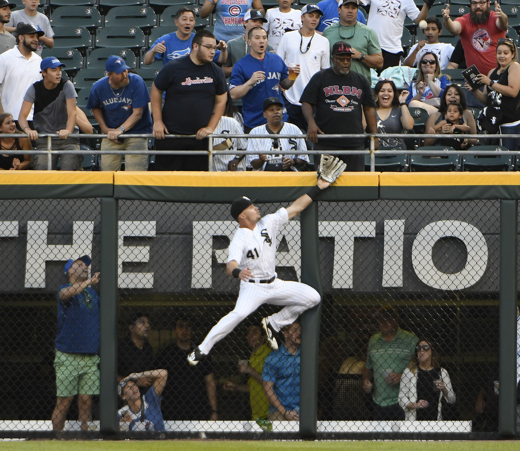 Chicago White Sox center fielder Adam Engel (41) can't make a catch on a home run hit by Toronto Blue Jays' Josh Donaldson during the first inning of ...