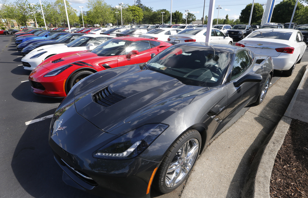 In this Wednesday, April 26, 2017, photo, Chevrolet Corvettes and other vehicles line the lot at a Chevrolet dealership in Richmond, Va. U.S. sales of...
