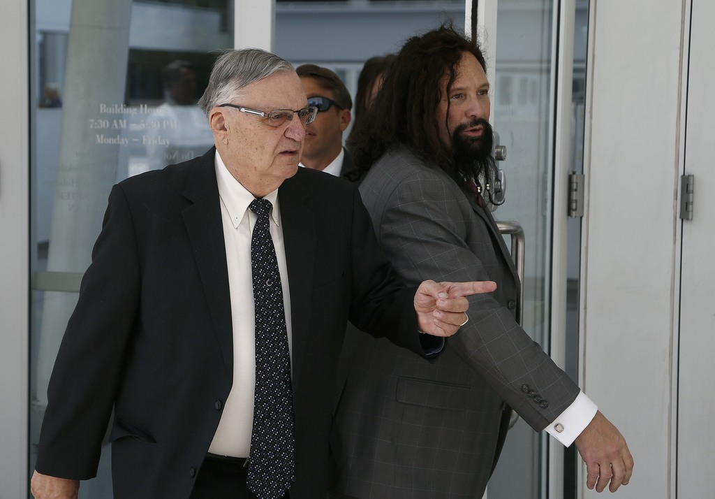 FILE--In this June 26, 2017, file photo, former Maricopa County Sheriff Joe Arpaio, left, leaves U.S. District Court on the first day of his contempt-...