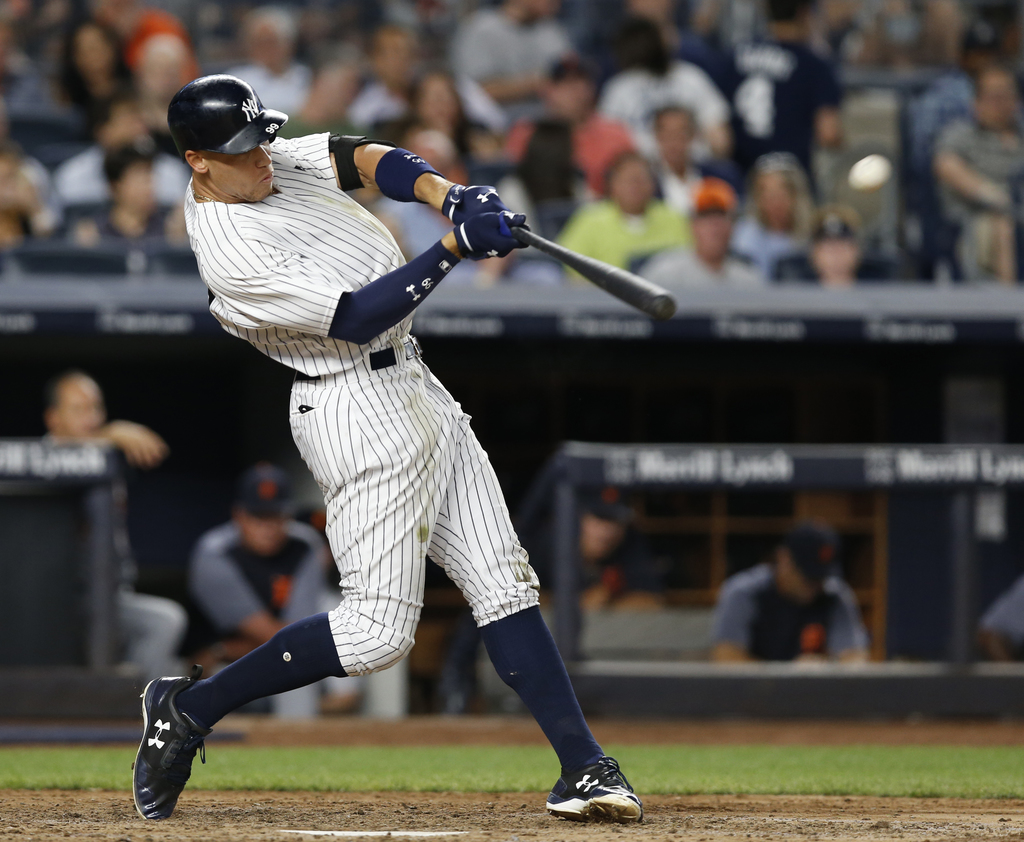 New York Yankees' Aaron Judge hits a solo home run during the fifth inning of a baseball game against the Detroit Tigers at Yankee Stadium in New York...