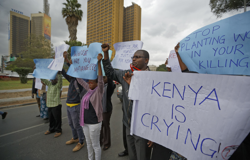 Members of civil society groups protest the killing of electoral commission information technology manager Christopher Msando, at a demonstration in d...
