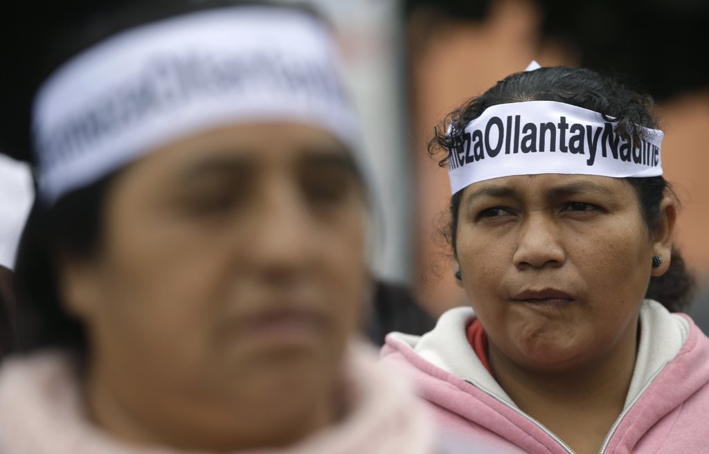 Supporters of Peru's former President Ollanta Humala and his wife Nadine Heredia, gather outside a courthouse where lawyers are asking that the former...