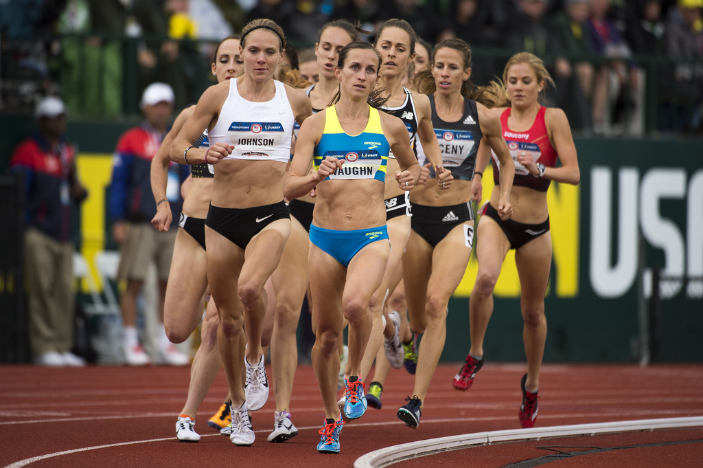 In this July 10, 2016, photo, Sara Vaughn, front right, leads during the final of the women's 1,500 meters with Lauren Johnson, left, during the Olymp...