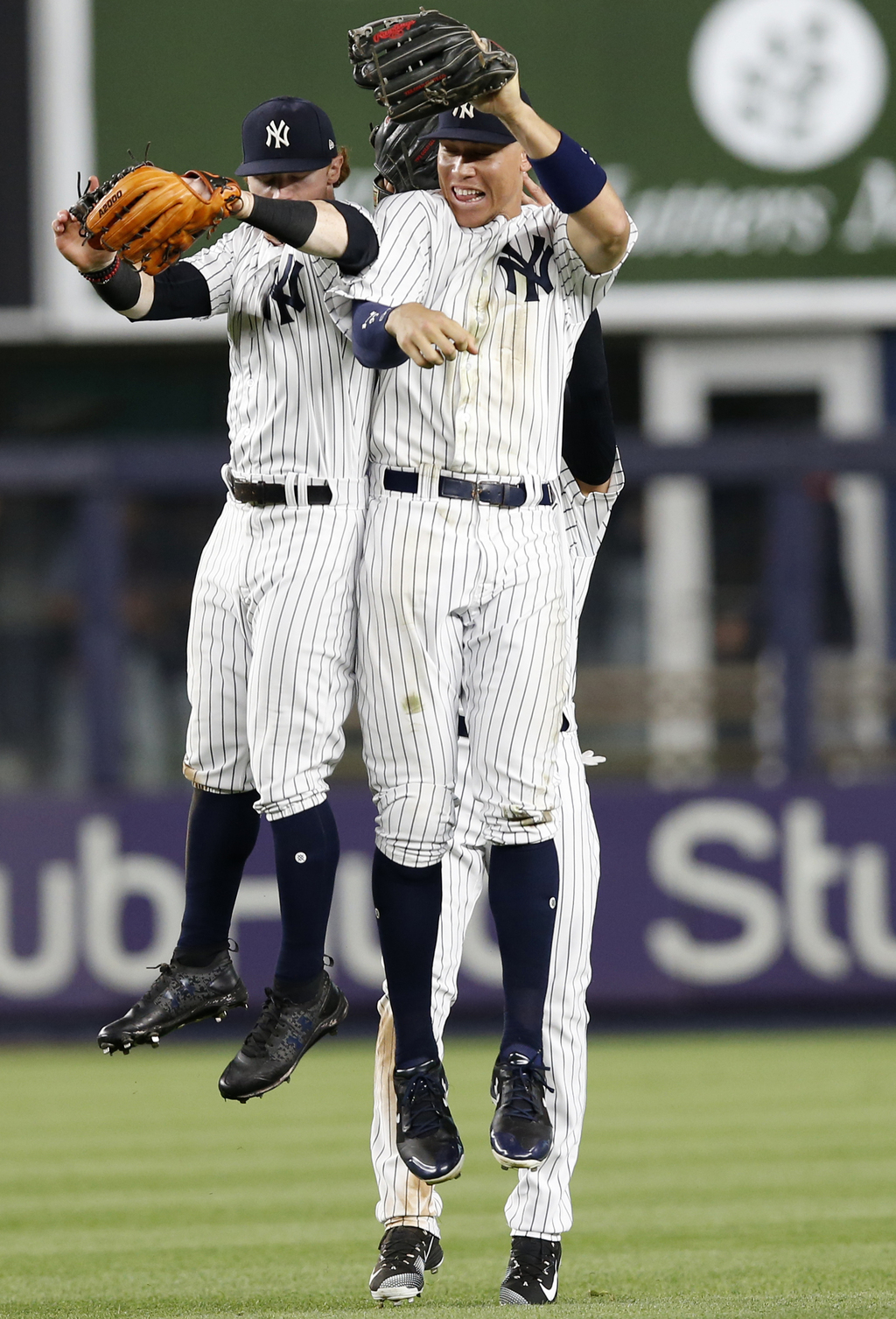 New York Yankees left fielder Clint Frazier (77) and New York Yankees right fielder Aaron Judge (99) celebrate after the Yankees 7-3 victory over the ...