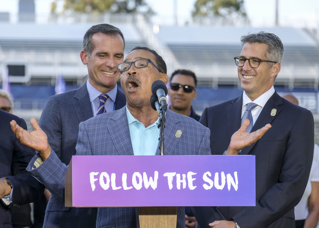 Los Angeles Mayor Eric Garcetti, left, and L.A. Olympic Committee leader Casey Wasserman, right, react as City Council President Herb Wesson speaks du...
