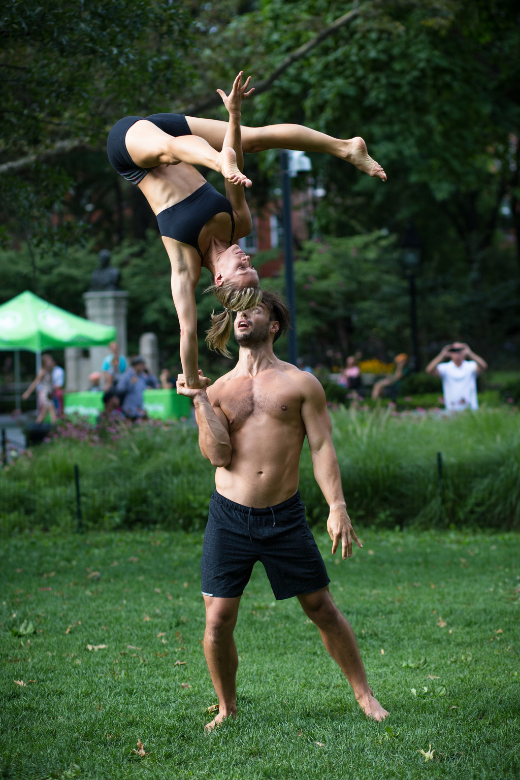 This undated photo provided by Peter Cooper shows Mike Aidala and Chelsey Khorus working on a skill called a Figa in New York's Washington Square Park...