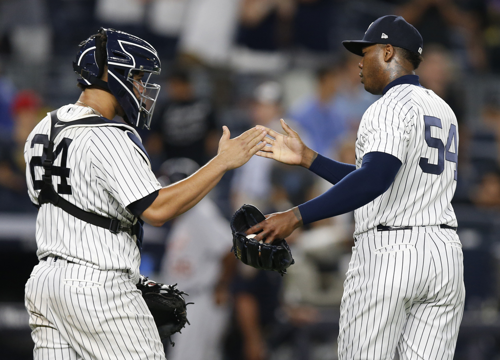 New York Yankees catcher Gary Sanchez (24) celebrates with Yankees relief pitcher Aroldis Chapman (54) after Chapman earned a save in the Yankees 7-3 ...