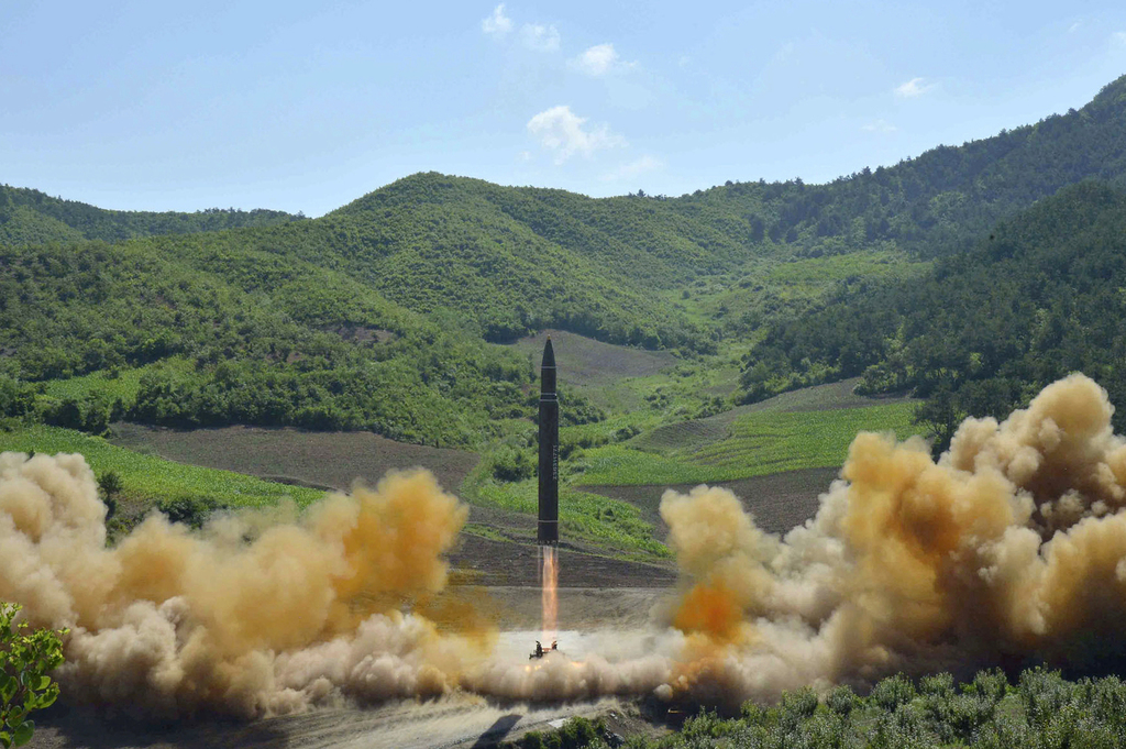 FILE- In this July 4, 2017, file photo distributed by the North Korean government shows what was said to be the launch of a Hwasong-14 intercontinenta...