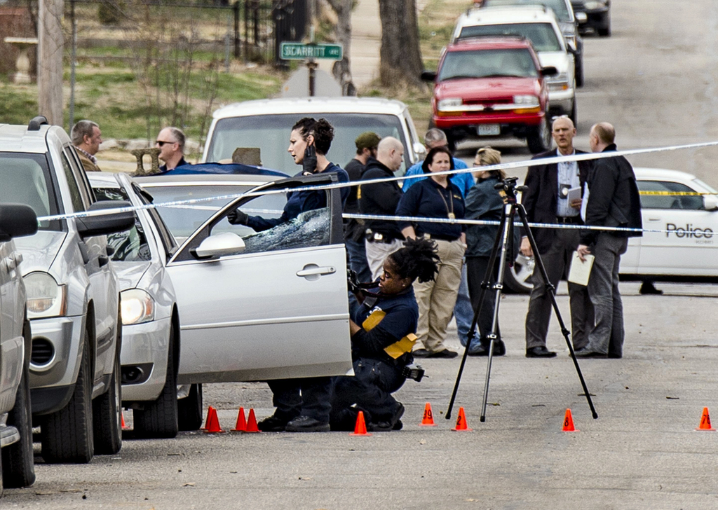 In a March 6, 2017 photo, Kansas City Police investigate a double shooting in the 100 block of North Drury Avenue in the Kansas City's northeast side ...