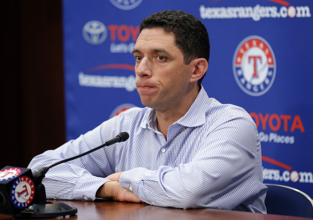 Texas Rangers general manager Jon Daniels responds to a question during a news conference about the trade of pitcher Yu Darvish before a baseball game...
