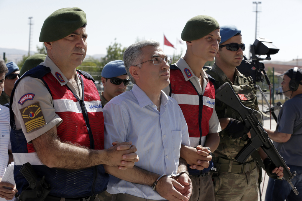 Paramilitary police and members of the special forces escort suspects of last year's failed coup, outside the courthouse at the start of a trial, in A...