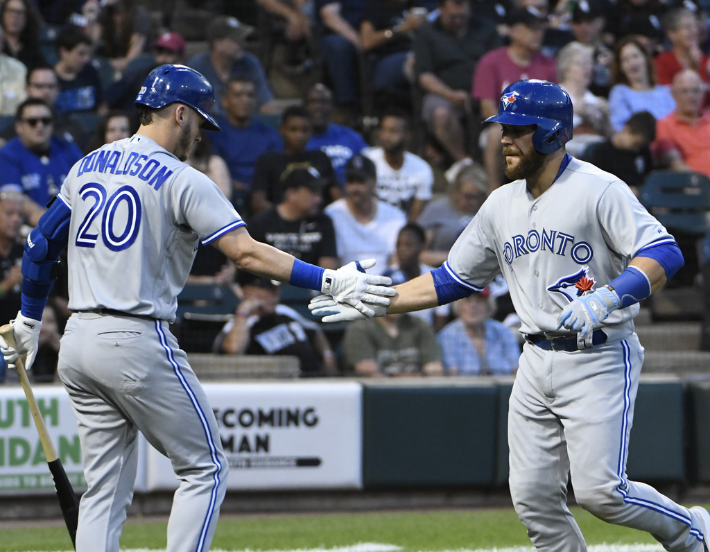 Toronto Blue Jays' Russell Martin, right, is greeted by Josh Donaldson (20) after hitting a home run against the Chicago White Sox during the fourth i...