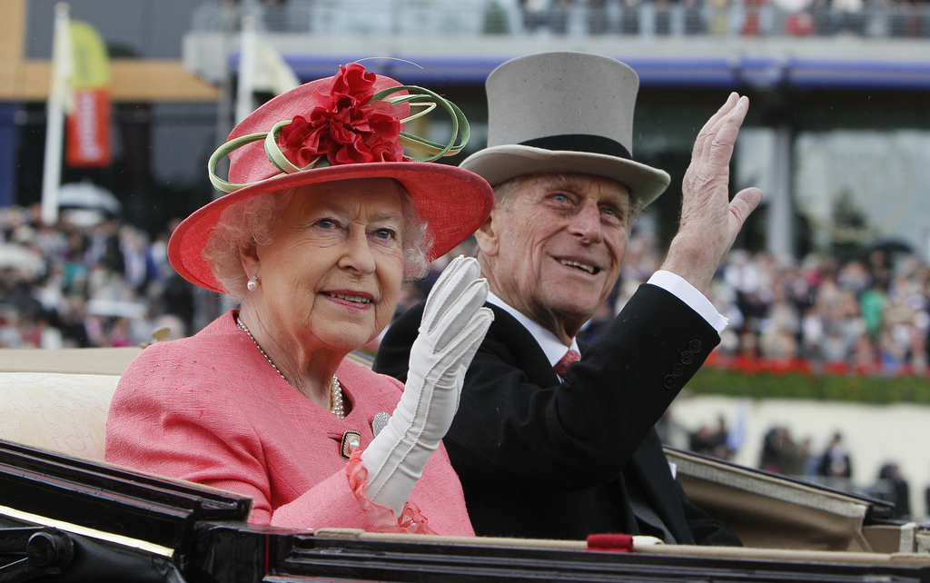 FILE - In this Thursday, June, 16, 2011 file photo Britain's Queen Elizabeth II with Prince Philip arrive by horse drawn carriage in the parade ring o...