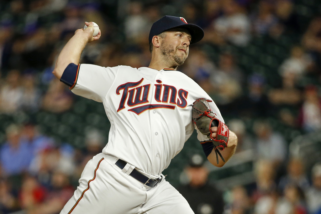FILE - In this June 20, 2017, file photo, Minnesota Twins relief pitcher Brandon Kintzler throws to the Chicago White Sox during the ninth inning of a...