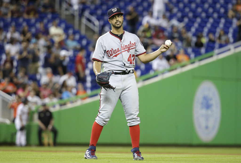 Washington Nationals starting pitcher Gio Gonzalez reacts after giving up a single to Miami Marlins' Dee Gordon to end his bid for a no-hitter during ...