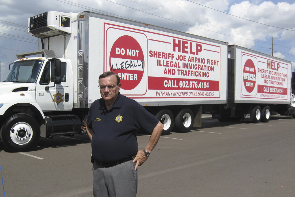 FILE--In this Sept. 16, 2007, file photo, Maricopa County Sheriff Joe Arpaio shows off vehicles advertising a hotline to report undocumented immigrant...