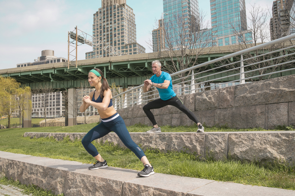 This undated photo provide by Jamie Hess shows Jamie and George Hess working out together in New York City. It's tempting to blow off a workout, but g...
