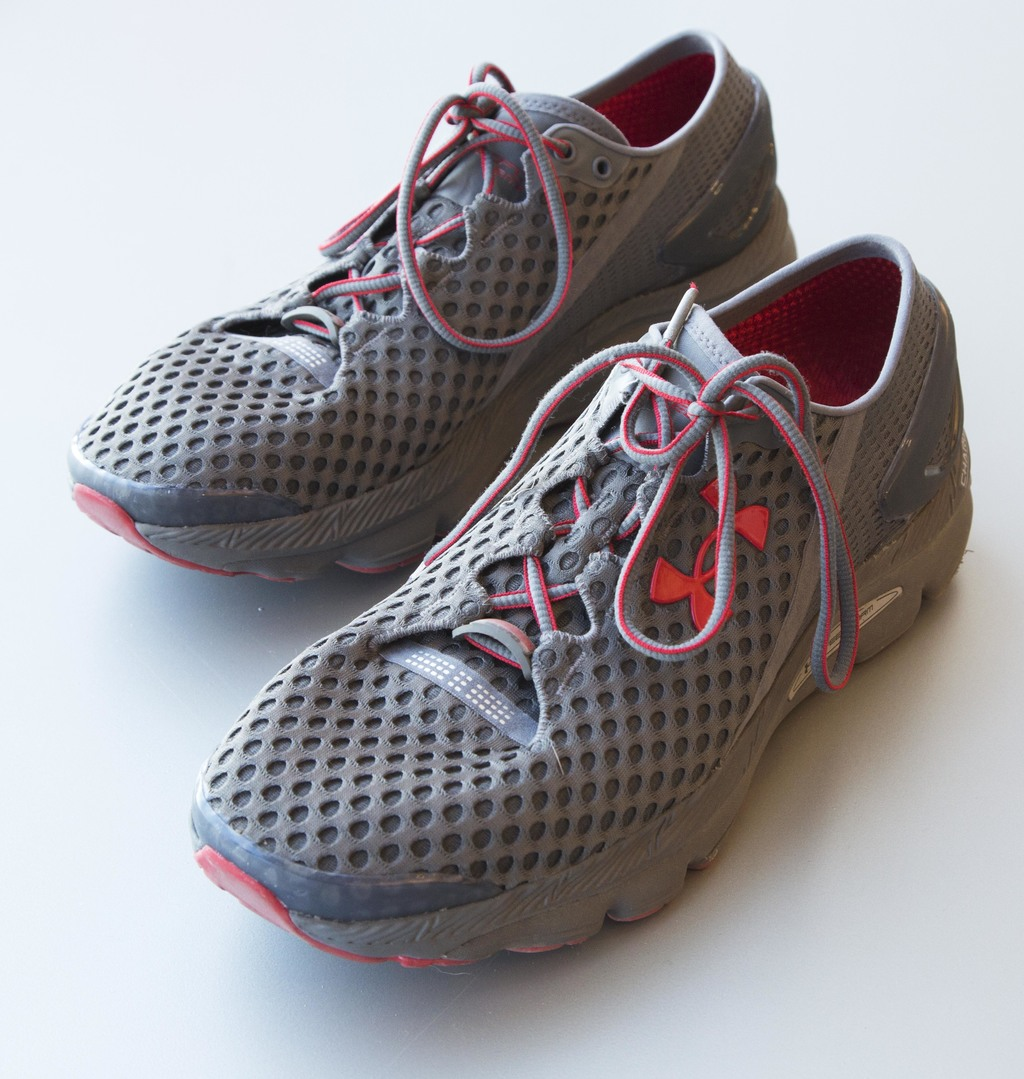 FILE - This Monday, Jan. 4, 2016, file photo, shows a pair of Under Armour SpeedForm Gemini 2 Record Equipped running shoes, containing an embedded ch...