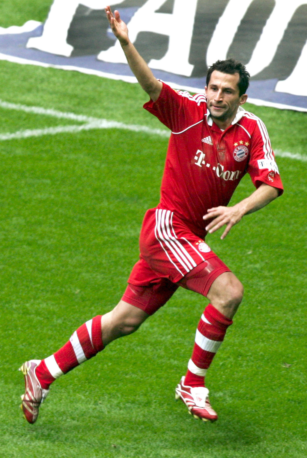 In This March 31, 2007 file photo Hasan Salihamidzic of Munich cheers while scoring  during the Bundesliga soccer match between  FC Bayern Munich and ...