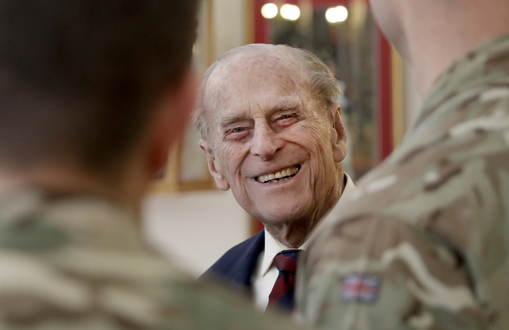 FILE - In this Thursday, March 30, 2017 file photo Britain's Prince Philip, in his capacity of Colonel, Grenadier Guards, chats to Sergeants from 1st ...