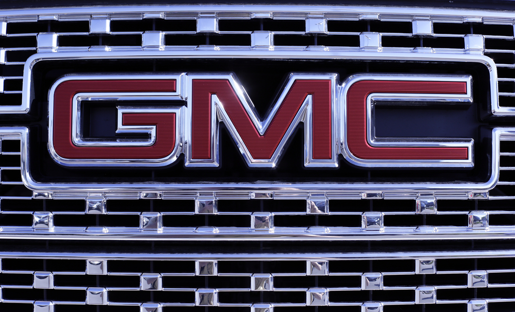 In this April 25, 2017, photo, a GMC truck sits in a General Motors dealer's lot in Nashville, Tenn. U.S. sales of new cars and trucks were expected t...