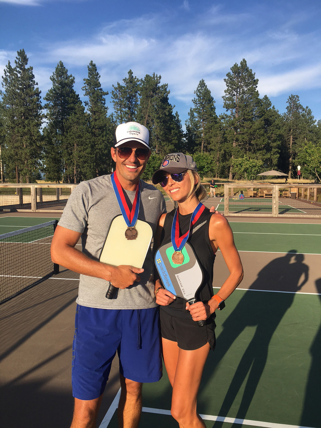 In this July 21, 2017 photo provided by Giuliana Rancic, Bill and Giuliana Rancic pose for a photo in Harrison, Idaho after winning a Mixed Doubles Pi...
