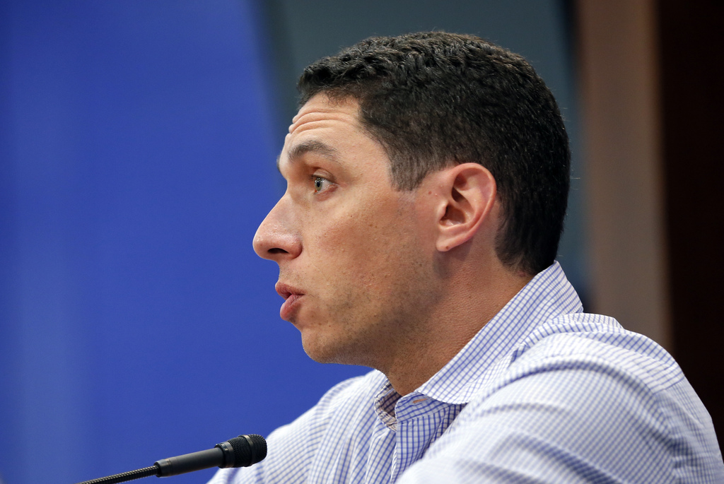 Texas Rangers general manager Jon Daniels responds to questions during a news conference about the trade of pitcher Yu Darvish before a baseball game ...